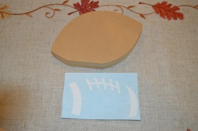 Wood football, vinyl lace pieces